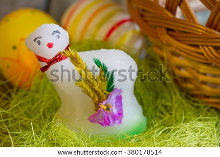 Easter sugar lamb and eggs on green grass - stock photo