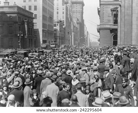 Easter Sunday crowd on Fifth Avenue, New York City, as thousands of worshippers left church to take part in the holiday promenade. Ca. 1925. - stock photo