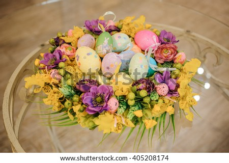 Easter table decoration with flowers and eggs on table  - stock photo