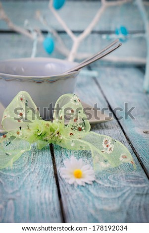 Easter table place setting. Easter table in a rustic vintage style. - stock photo