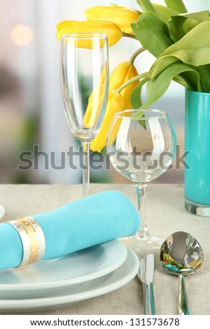 Easter table setting on bright background - stock photo