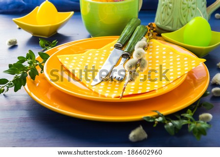 Easter table setting with a sprig of pussy willow - stock photo