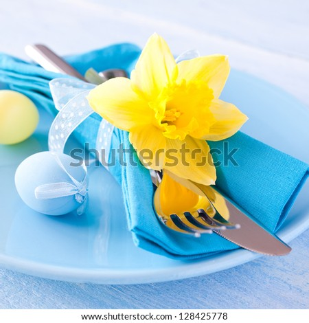 easter table setting with daffodil and cutlery - stock photo