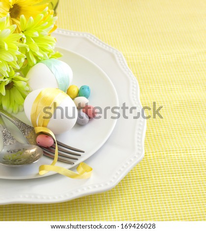Easter table setting with flowers and eggs  - stock photo
