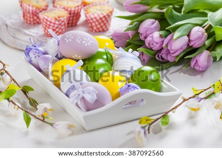 Easter table setting with painted eggs - stock photo