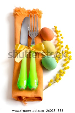 Easter table setting with yellow mimosa and eggs - stock photo