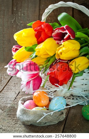 Easter tulip flowers in wooden background - stock photo