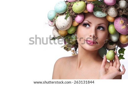 Easter Woman. Portrait of Beautiful Model with Colorful Eggs. - stock photo