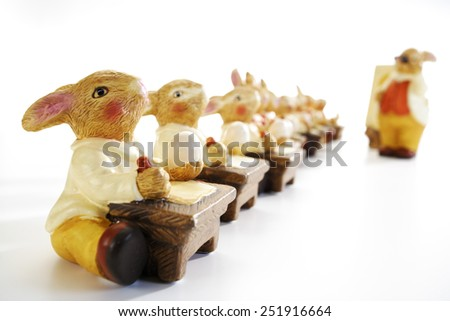 Eastern, Easter bunny figurines at school - stock photo