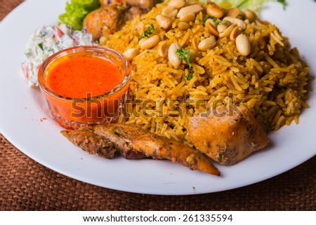 Eastern food. Arab food. Pilaf with meat. Rice with meat and vegetables. Healthy eating, delicious food. - stock photo