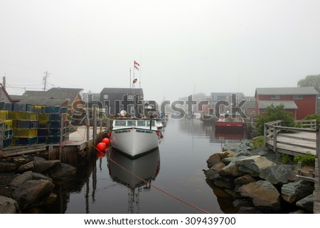EASTERN PASSAGE -  AUGUST 4, 2015: The picturesque village of Eastern Passage, just outside Halifax, Nova Scotia on a foggy atmospheric day. - stock photo