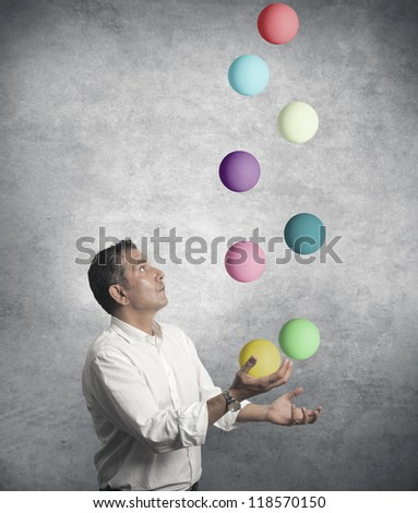 Easy business concept with juggler businessman - stock photo
