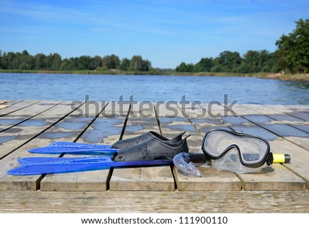 Easy diving set on a wooden bridge - stock photo