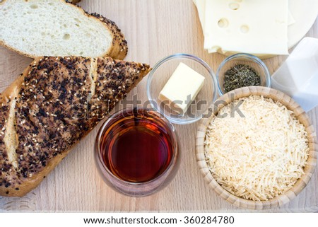 Easy french onion soup ingredients on wood cutting board and wood background, French onion soup ingredients - stock photo