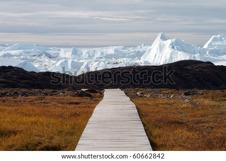 Easy hiking route to the famous Kangia glacier near Ilulissat in Greenland - stock photo
