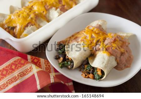 Easy Vegetable Enchiladas, vegetarian dinner casserole - stock photo