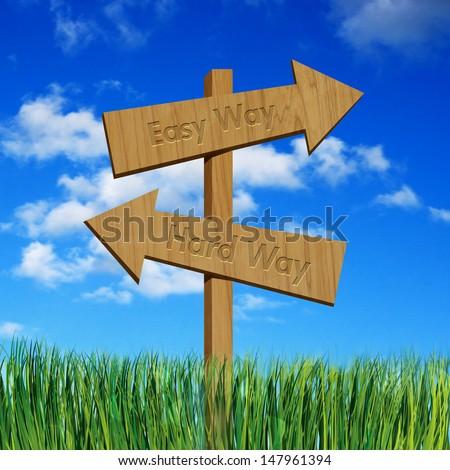 Easy way and hard way on wooden sign board - stock photo