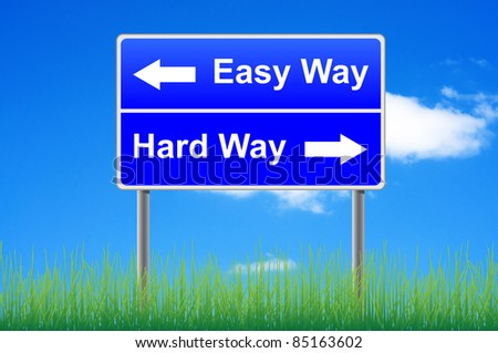 Easy way, hard way roadsign with arrows. Grass underneath. - stock photo