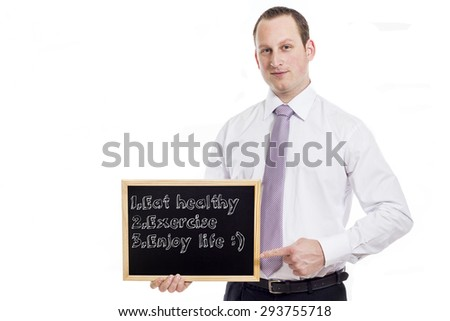 Eat healthy, exercise, Enjoy life - Young businessman with blackboard - isolated on white - stock photo