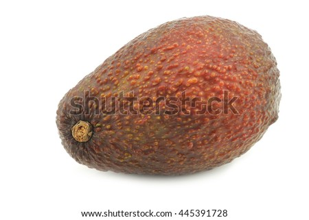 Eat ripe avocado on a white background - stock photo