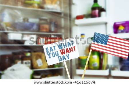eat what you want day 11th May. a note with American (USA) flag against a blur defocus background refrigerator. filter sunlight, toned image.