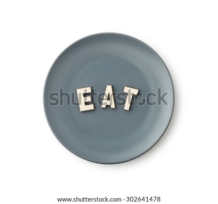 Eat , Wooden alphabet blocks in plate, clipping path - stock photo