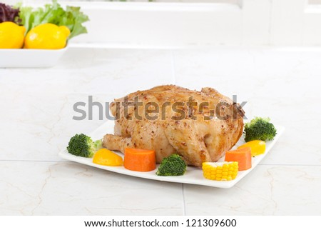 Eatable whole roasted chicken served with vegetable - stock photo