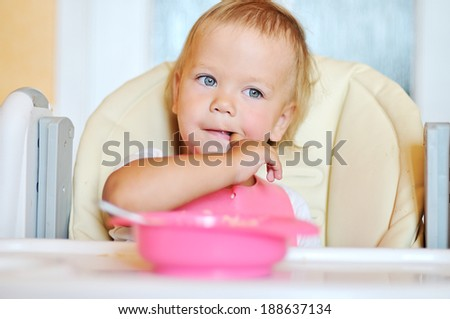 eating baby with finger in mouth
