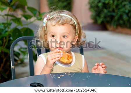 Eating cake with great enthusiasm scattering crumbs around. - stock photo