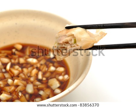 Eating fired chinese dumpling