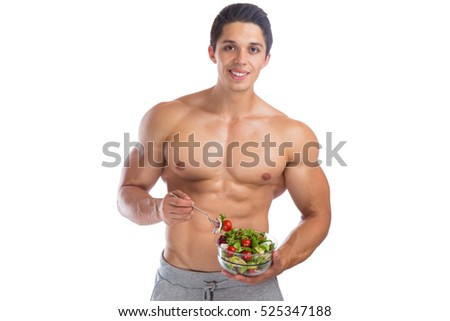 Eating food salad bodybuilding bodybuilder body builder building muscles muscular young man isolated on a white background