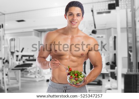 Eating food salad bodybuilding bodybuilder gym body builder building muscles muscular young man studio