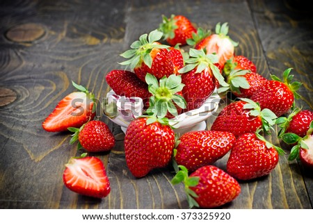 Eating healthy food - organic strawberries - stock photo