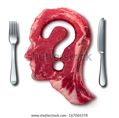 Eating meat questions concept or diet and nutrition decisions as a red steak in the shape of a human head with a question mark cut out of the raw food as a dinner table setting with a fork and knife. - stock photo