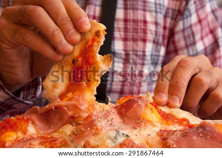 Eating pizza with fingers in an italian restaurant. - stock photo