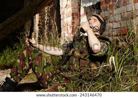 Eating soldier on patrol - stock photo