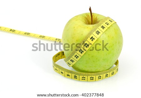 Eating Sour Green Apple Skins Help You Lose Weight . ( Soft focus , lens blur ) Green apple with measuring tape on white background .