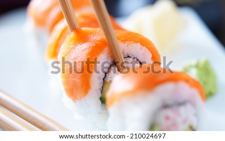 eating sushi with chopsticks panorama