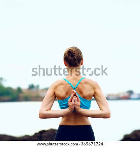 eautiful girl with clasped hands in namaste, yoga concept - stock photo