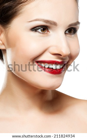 eautiful woman face. Perfect toothy smile. Caucasian young girl close up portrait. red lips, skin, teeth. Isolated on white background. Studio shot . happy positive girl.