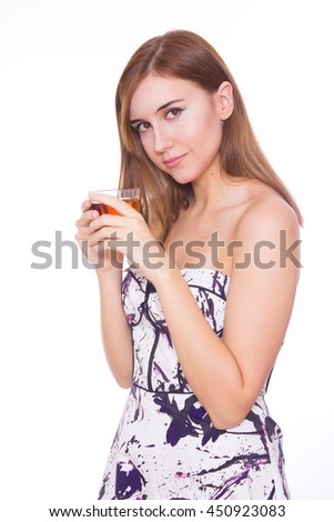 eautiful young woman with cup of tea on white background