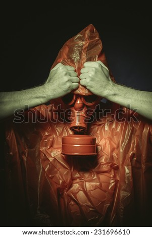 Ebola infection concept, man with red gas mask - stock photo
