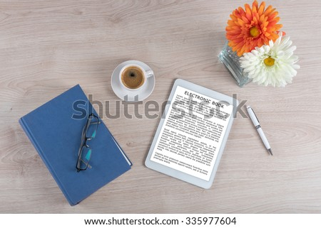 Ebook, coffee and book, top view (lorem ipsum text used) - stock photo