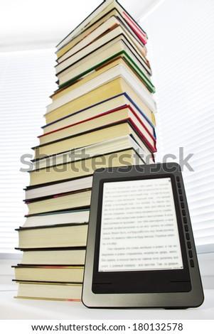 Ebook reader on a light background window - stock photo