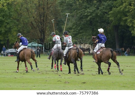 EBREICHSDORF, AUSTRIA -SEPTEMBER 10: horsemen from Germany (blue) and Switzerland (grey) by European Polo Championship on September 10, 2010 in the fields of Castle Ebreichsdorf in Lower Austria