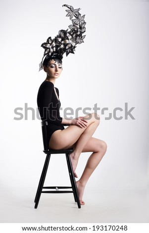 Eccentric Glamorous Woman in Surreal Metallic Headwear. Fancy Crown - stock photo