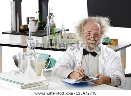 Eccentric senior scientist in lab holds pen and clipboard. High key, white background, horizontal, copy space. - stock photo