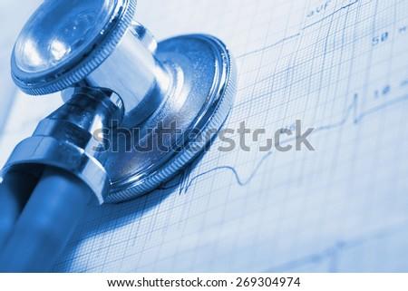 ECG and stethoscope medical examination tools - stock photo