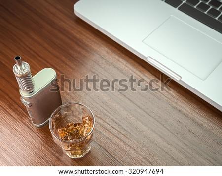 Ecig battery mod plus whiskey glass - stock photo