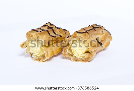 Eclairs with chocolate on white background